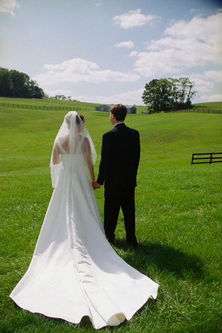 Bride and Groom in Grassy Meadow